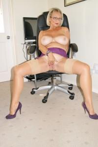Busty MILF in purple panties masturbating