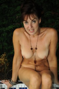 Mature MILF bathing nude