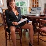 Horny secretary strips after a long days work