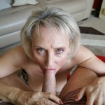 Mature MILF bending over & hitching up her skirt to show her hot ass